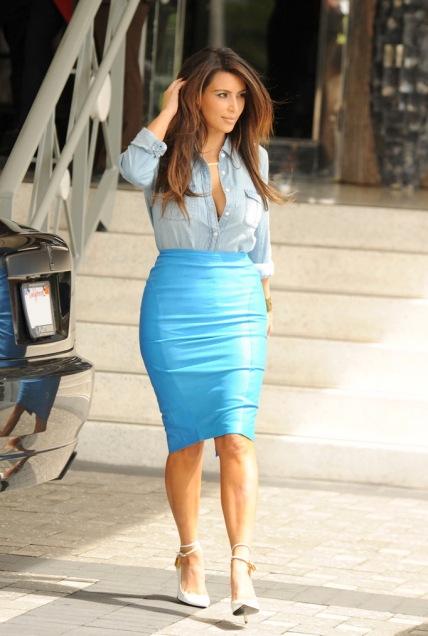 Kim Kardashian  wearing a denim shirt tucked into a blue skirt October 2012